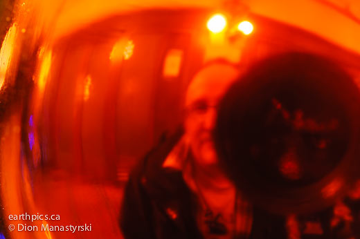 My reflection in a red glass bulb, Repro-Nikkor 85mm at F2.8 marked aperture, Nikon D700.